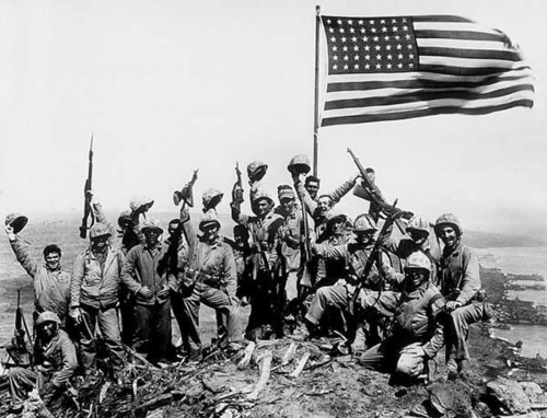 celebrating_the_flag_raising_on_iwo_jima-e1401734876760